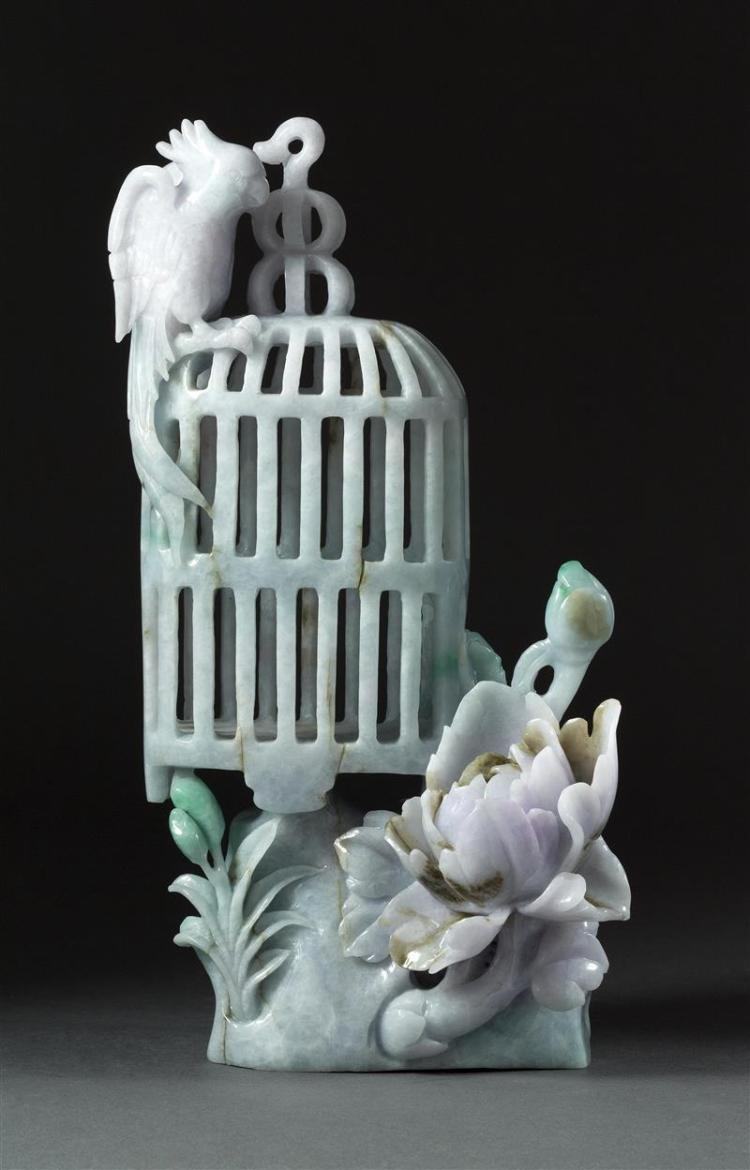 GREEN AND LAVENDER JADEITE CARVING In the form of a birdcage, cockatoo, and peony. Height 10.6