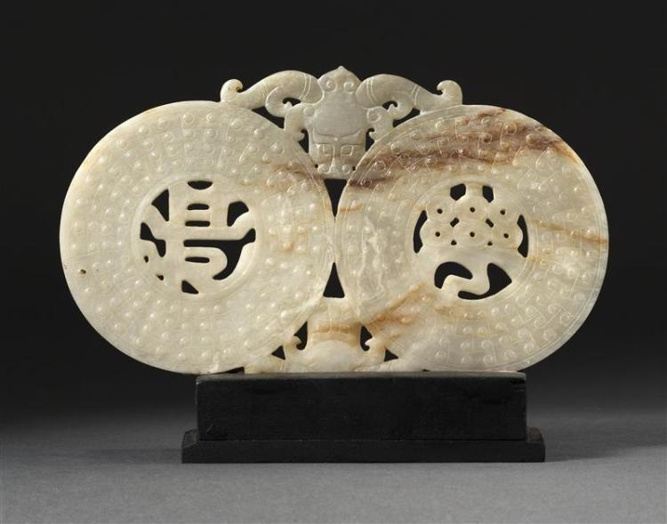 WHITE AND RUSSET JADE DOUBLE BI CARVING With central shou designs and ox-head carvings. Length 6.8