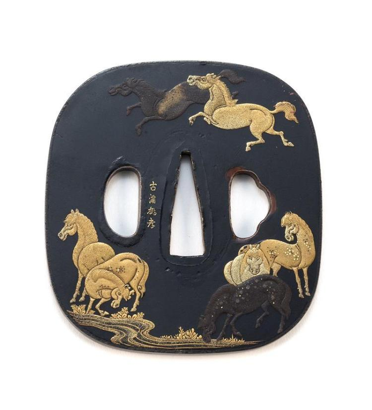 LACQUER-ON-COPPER TSUBA In a design of horses watering at a stream. Executed in shades of gold on a black ground. Signed. Length 3