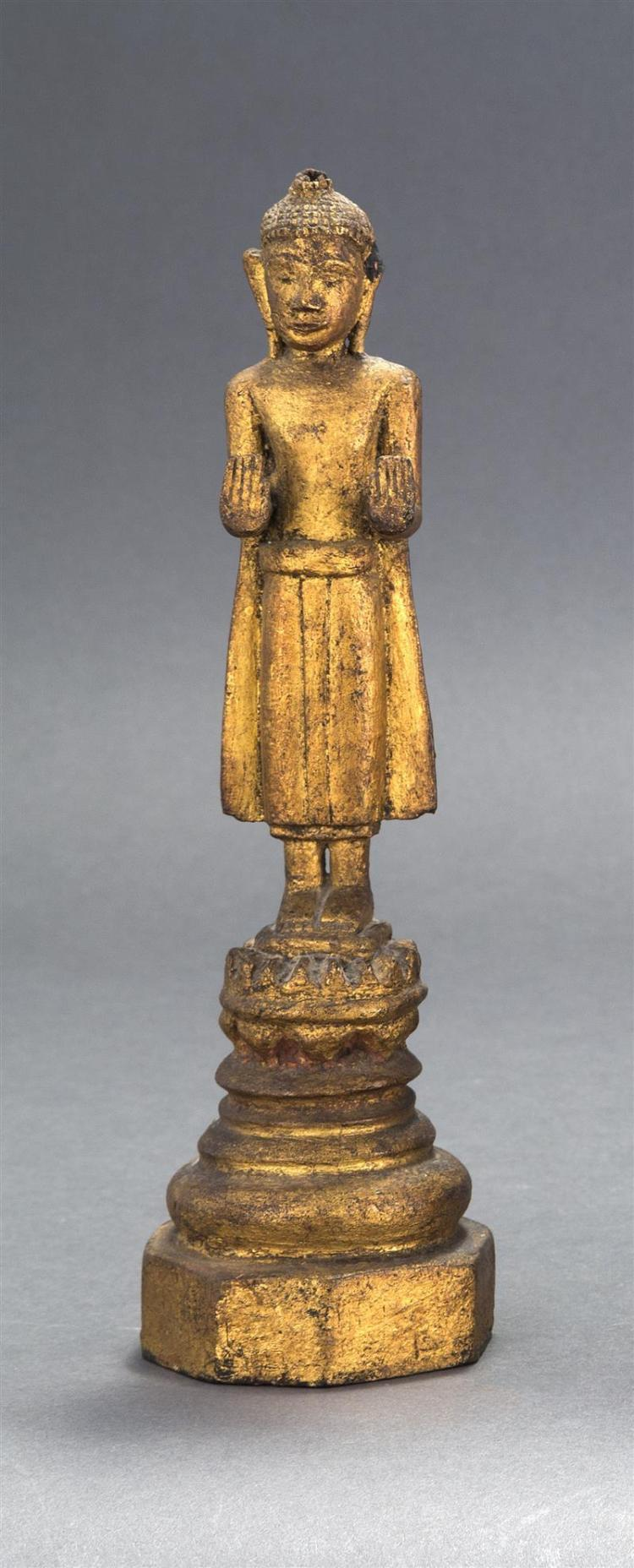 GILTWOOD STATUE OF BUDDHA Standing on a multi-tiered lotus throne base with palms facing out. Height 10.5