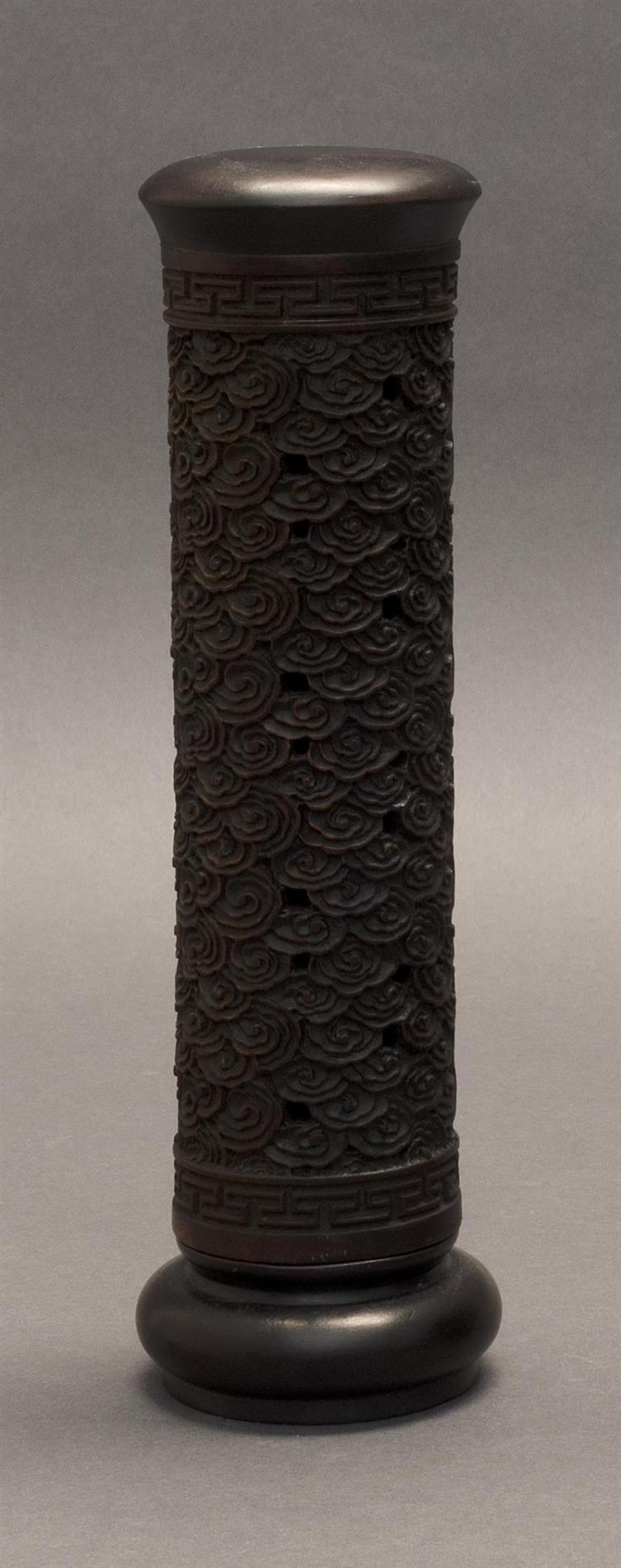 WOOD INCENSE HOLDER In cylindrical form. With carved ryui design about the body and key fret banding at top and base. Height 8.5