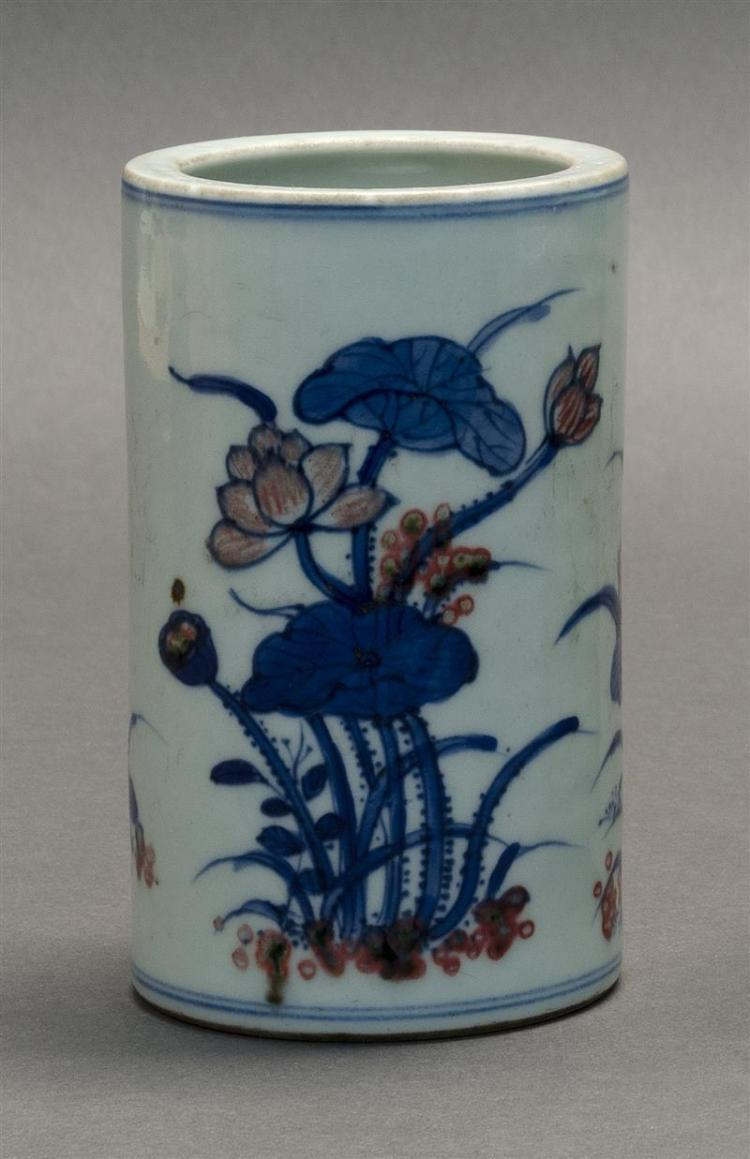 UNDERGLAZE BLUE AND RED PORCELAIN BRUSH POT In cylindrical form with lotus flower decoration. Double ring mark at base. Height 5