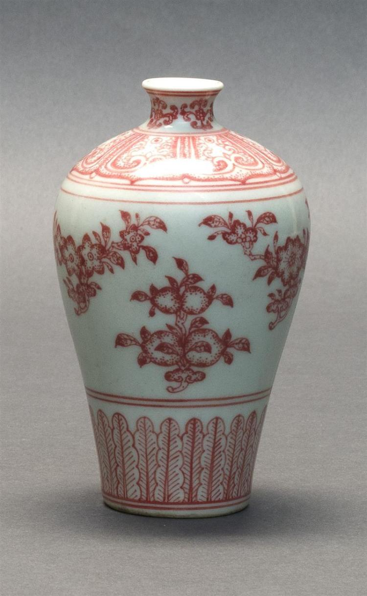 IRON-RED PORCELAIN VASE In meiping form. With central peach decoration, floral swags about the body and neck, a lappet design at sho...