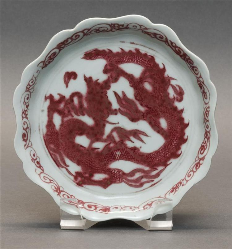 IRON-RED PORCELAIN SHALLOW DISH With a shaped edge and central qilin decoration. Diameter 6.5