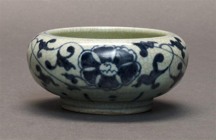 UNDERGLAZE BLUE AND WHITE PORCELAIN WRITER''S COUPE On a crackleware ground with lotus and vine decoration. Height 2.25