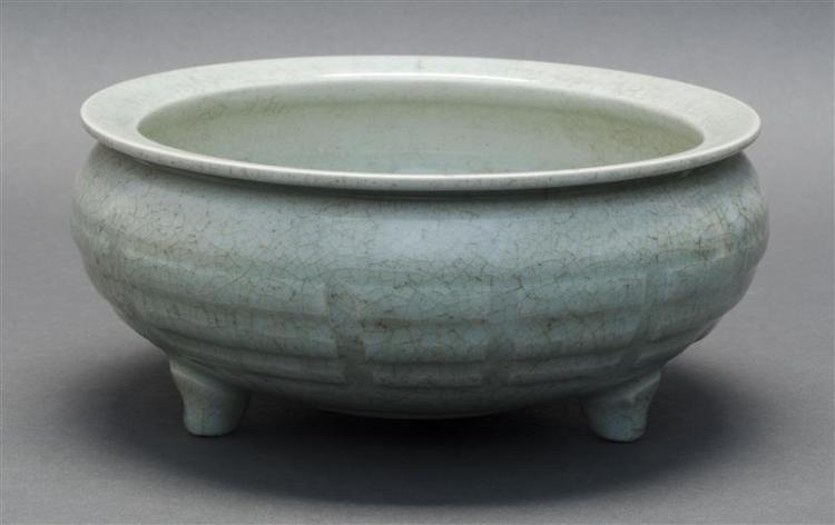 CELADON CRACKLEWARE PORCELAIN TRI-FOOT BOWL In squat ovoid form. Geometric raised decoration about the body. Height 4