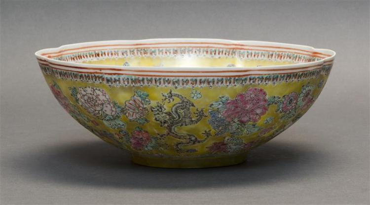 FAMILLE JAUNE PORCELAIN BOWL In flower form. Exterior and interior with peony and five-claw dragon decoration on a yellow ground. Ce...