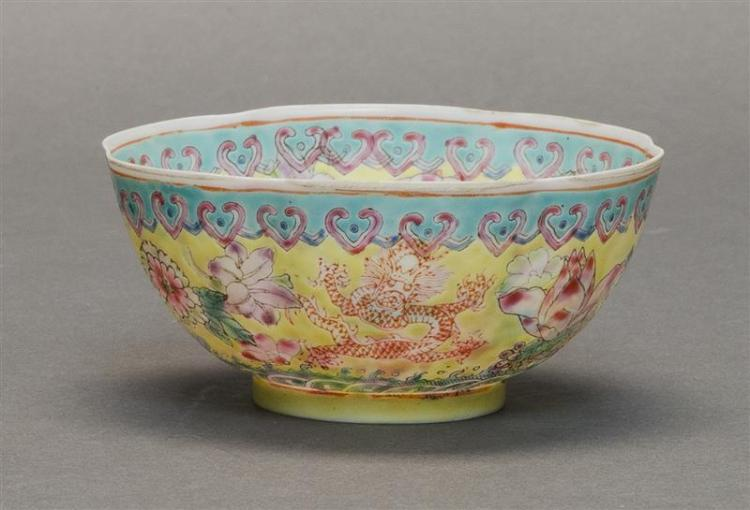 FAMILLE JAUNE EGGSHELL PORCELAIN BOWL In flower form. With peony and five-claw dragon design on interior and exterior. Dragon medall...