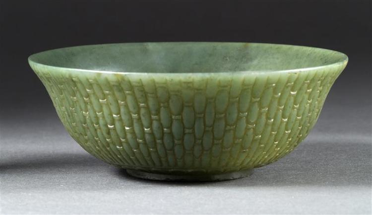 CARVED SPINACH-GREEN JADE BOWL Exterior in allover basket weave pattern. Height 2