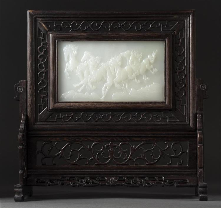 VIETNAMESE CARVED WHITE STONE PLAQUE In rectangular form with raised depiction of running horses. Housed in a openwork carved fruitw...