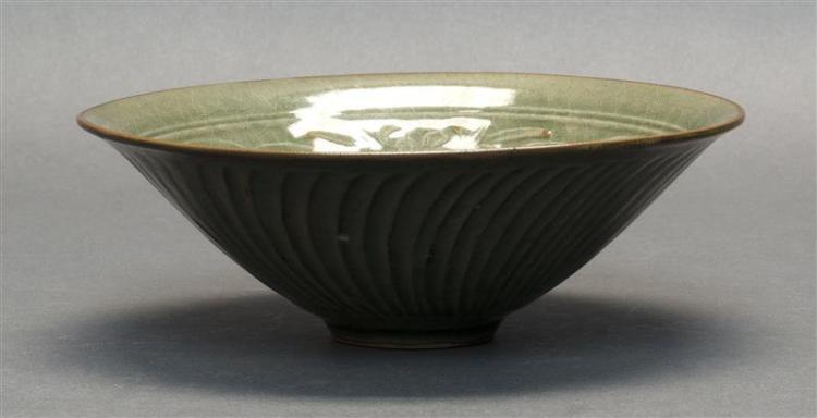 LONGQUAN PORCELAIN CELADON BOWL In conical form with interior decoration of songbirds with flowers. Height 2.75