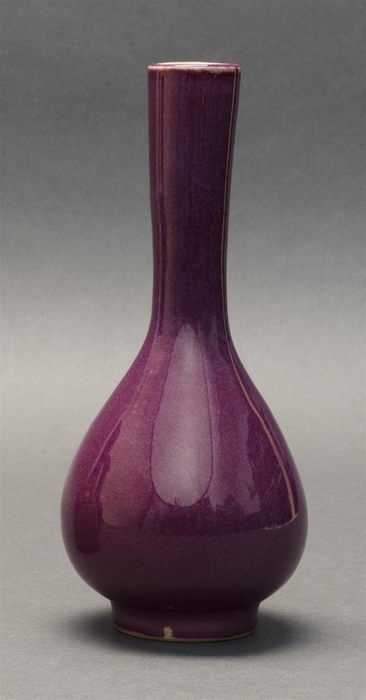 RICH PURPLE GLAZE PORCELAIN VASE In teardrop form with elongated neck on a slight foot. Incised calligraphic marks on base. Height 8
