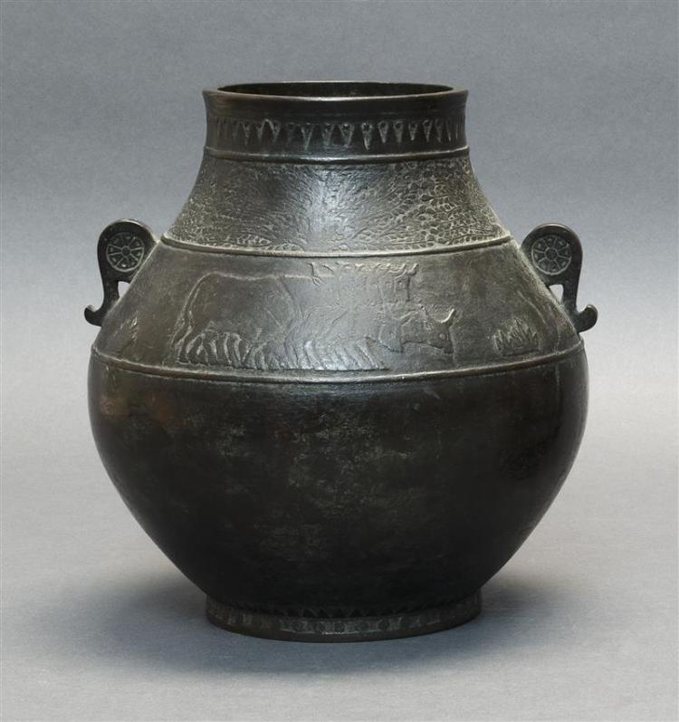 BRONZE VASE In ovoid form with tapered neck and wheel-form handles. A band of water buffalo at shoulder. Three-character calligraphi...