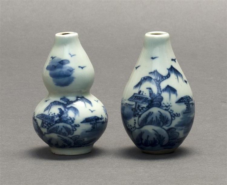 TWO DIMINUTIVE BLUE AND WHITE PORCELAIN BOTTLE VASES One in double gourd form, the other in seed form. Both with landscape decoratio...