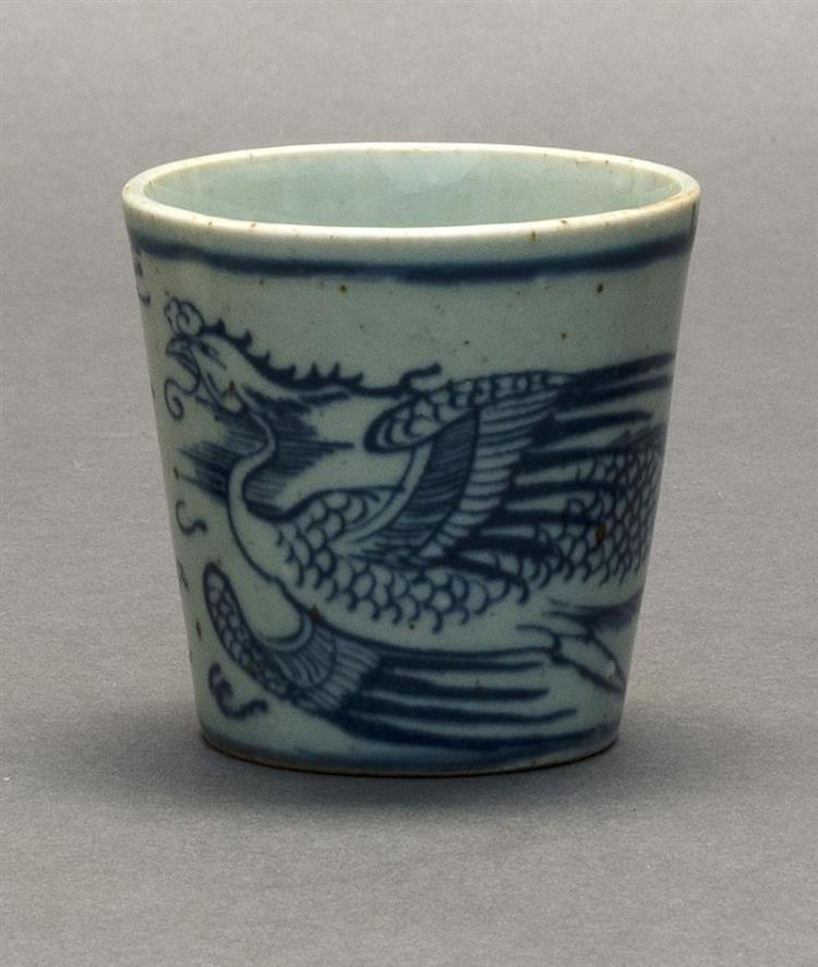 UNDERGLAZE BLUE AND WHITE PORCELAIN CUP In tapered cylindrical form. Decorated with a phoenix and dragon chasing a flaming pearl. He...