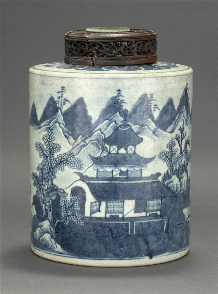 BLUE AND WHITE COVERED PORCELAIN STORAGE JAR In cylindrical form with landscape decoration. Carved wood cover with pierced jade inse...