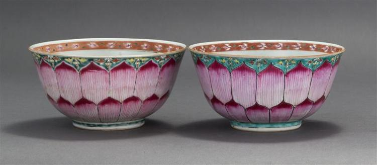 NEAR PAIR OF FAMILLE ROSE PORCELAIN BOWLS In bell form. With lotus petals on exterior and a single lotus flower blossom on interior...