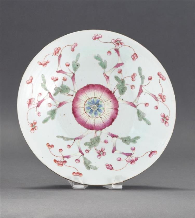 FAMILLE ROSE PORCELAIN DISH Floral branches emanate from a central lotus flower design. Diameter 12