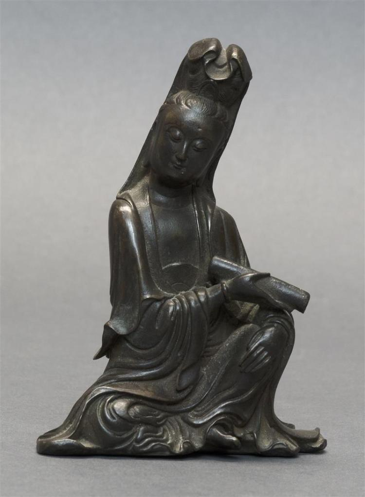 BRONZE FIGURE OF THE GODDESS GUANYIN Seated while holding a scroll. Height 4.5