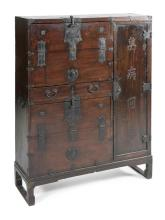 KOREAN APOTHECARY CHEST In elmwood. With Korean characters on right door which opens to reveal three columns of labeled drawers. The...