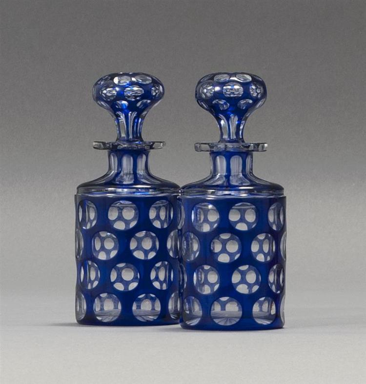 PAIR OF SANDWICH GLASS COMPANY CUT OVERLAY PUNTY GLASS COLOGNE BOTTLES In cobalt blue cut to clear. Both retain original stoppers. H...