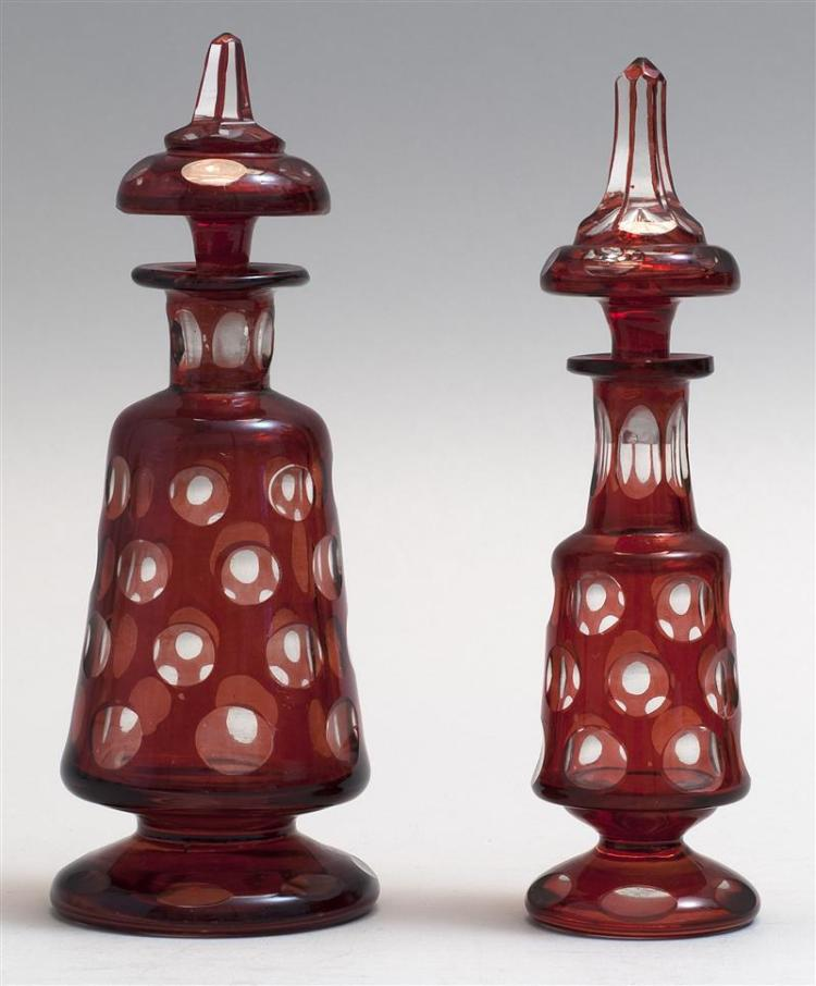 TWO SANDWICH GLASS COMPANY CUT OVERLAY PUNTY GLASS COLOGNE BOTTLES In cranberry cut to clear. Retain original stoppers. Heights appr...