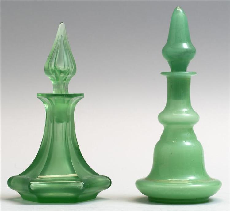 """TWO GLASS COLOGNE BOTTLES Both in green. One from Bristol, England, height 7"""", and one French, height 6.5"""". From a Cape Cod Collecti..."""