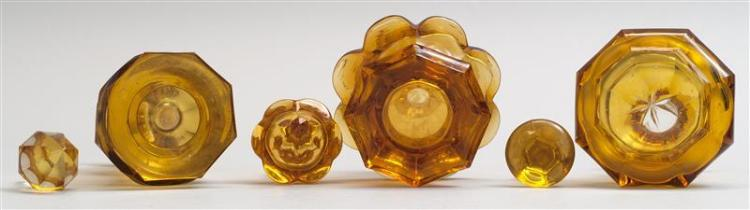 THREE CUT GLASS COLOGNE BOTTLES All in amber. Heights from 5