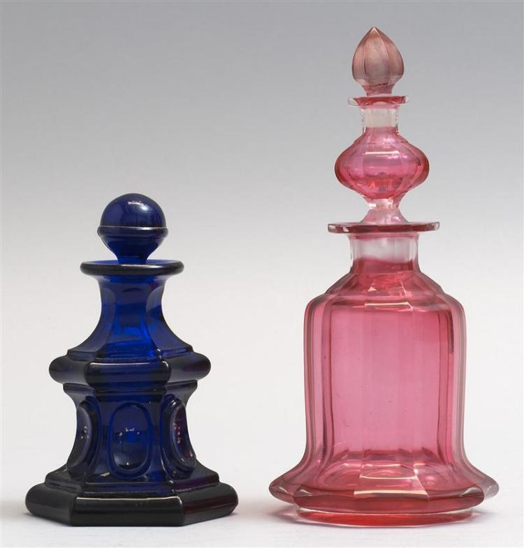 """TWO GLASS COLOGNE BOTTLES 1) Sandwich Glass Company bottle in Loop pattern in cobalt blue. Replacement stopper. Height 4.5"""". 2) Unus..."""