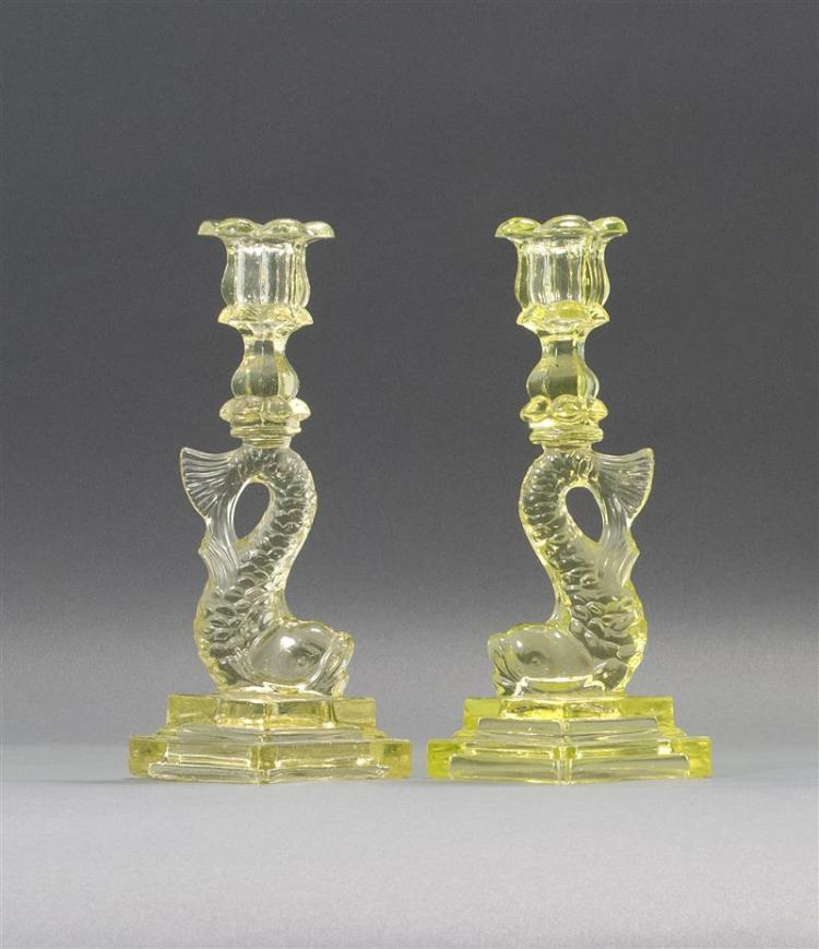 """PAIR OF SANDWICH GLASS COMPANY PRESSED GLASS DOLPHIN CANDLESTICKS In canary yellow. Double-stepped bases. Heights 10"""". From a Cape C..."""