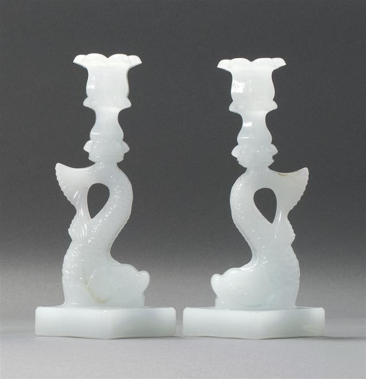 """PAIR OF SANDWICH GLASS COMPANY PRESSED GLASS DOLPHIN CANDLESTICKS In clambroth. Single-step bases. Heights 10.25"""". From a Cape Cod C..."""