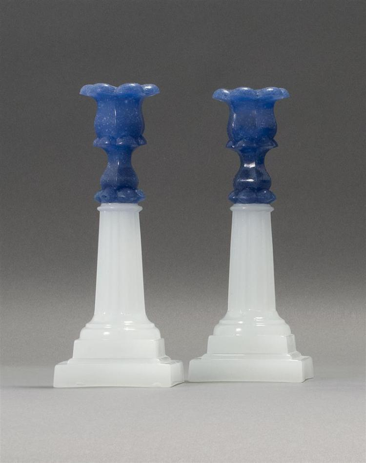 PAIR OF SANDWICH GLASS COMPANY PRESSED GLASS COLUMN CANDLESTICKS Opaque purple socles and stems on clambroth columns and double-step...