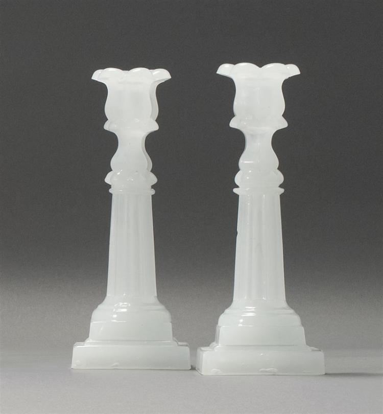 """PAIR OF SANDWICH GLASS COMPANY PRESSED GLASS COLUMN CANDLESTICKS In clambroth. Double-stepped bases. Heights 9.25"""". From a Cape Cod..."""
