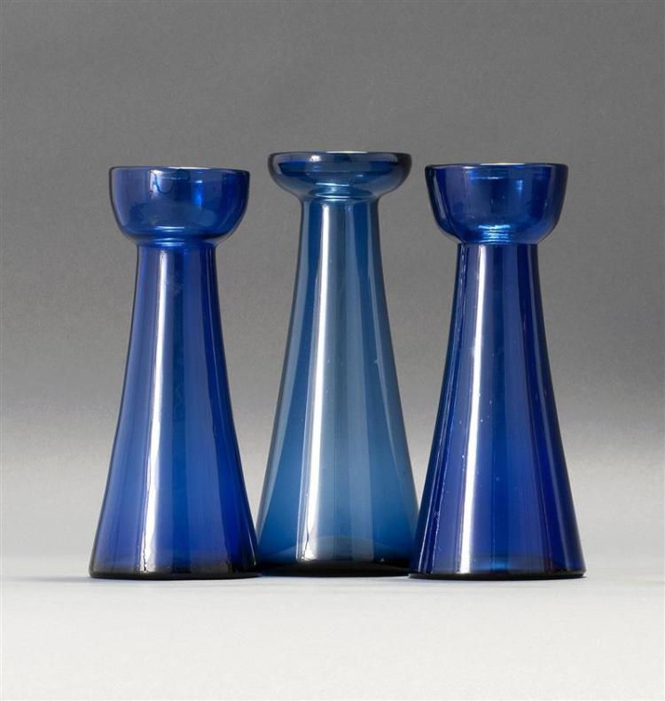 "THREE SANDWICH GLASS COMPANY HYACINTH VASES Two blown-molded and one free-blown. All in cobalt blue. Heights from 8.25"" to 8.75"". Fr..."