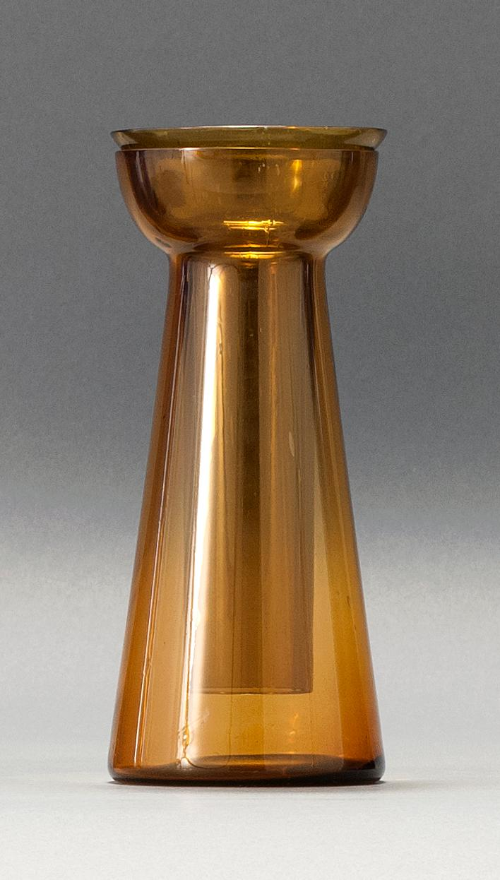"""SANDWICH GLASS COMPANY FREE-BLOWN HYACINTH VASE In amber. Includes period liner in similar shade of amber. Height 7.25"""". From a Cape..."""