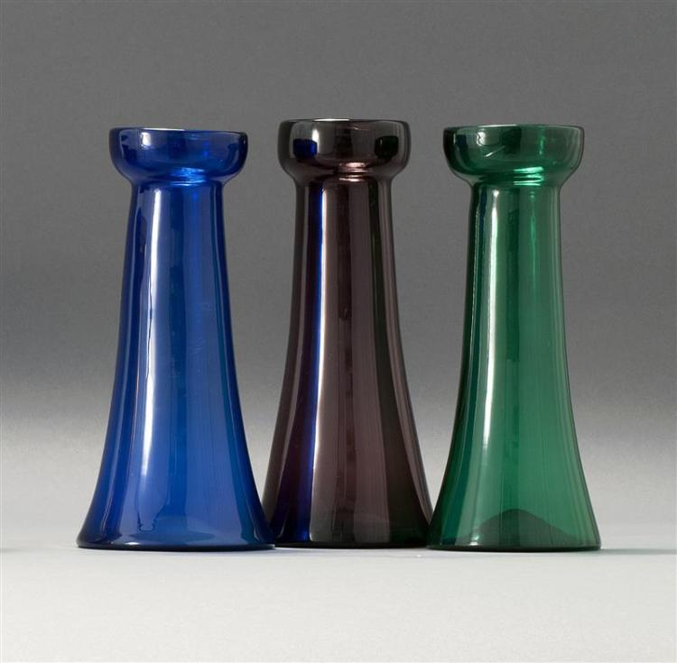 THREE SANDWICH GLASS COMPANY FREE-BLOWN HYACINTH VASES One in cobalt blue, one in emerald green and one in amethyst. Slightly varied...