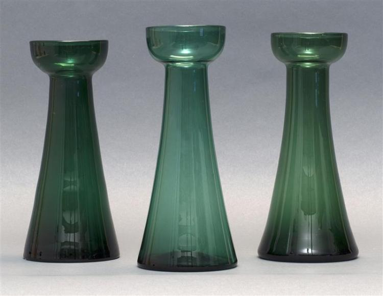 """THREE SANDWICH GLASS COMPANY FREE-BLOWN HYACINTH VASES All in shades of green. Slightly varied forms. Heights from 8"""" to 8.5"""". From..."""