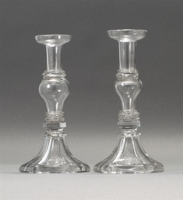 """PAIR OF SANDWICH GLASS COMPANY CLEAR GLASS CANDLESTICKS Free-blown stems and socles on pressed hexagonal bases. Heights 10.25"""". From..."""
