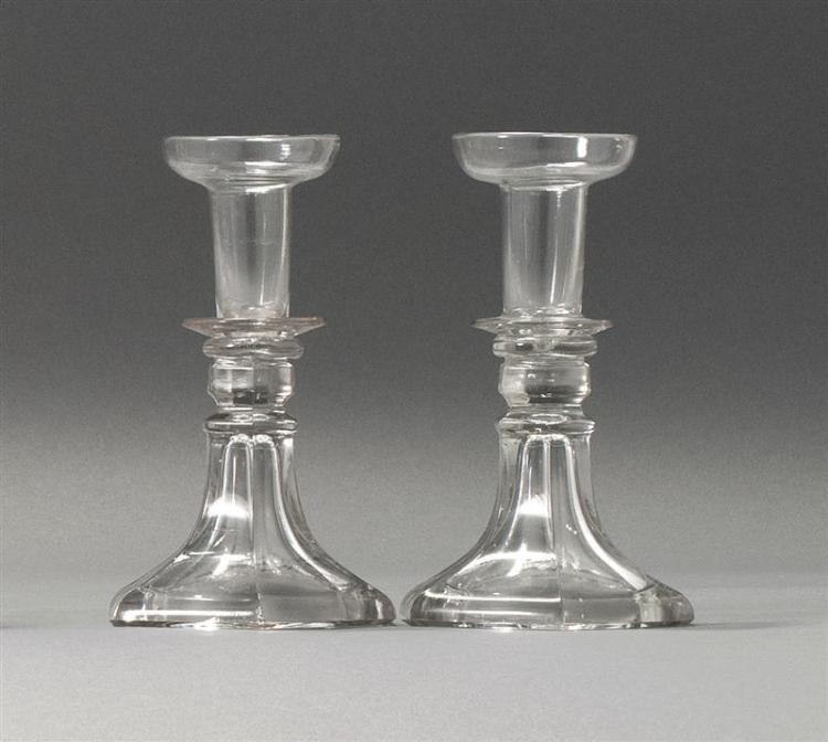 """PAIR OF SANDWICH GLASS COMPANY CLEAR GLASS CANDLESTICKS Free-blown socles on pressed bases. Heights 6.5"""". From a Cape Cod Collection..."""