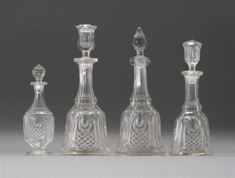 FOUR SANDWICH GLASS COMPANY FLINT PATTERN GLASS DECANTERS All in New England Pineapple pattern in clear. Two with quart capacity, on...