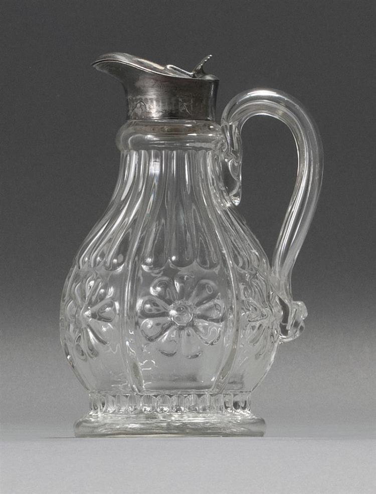 """CLEAR GLASS BLOWN 3-MOLD SYRUP McKearin #GV-11. Bold applied strap handle. Applied silver plated pouring lip. Height 7.5"""". From a Ca..."""