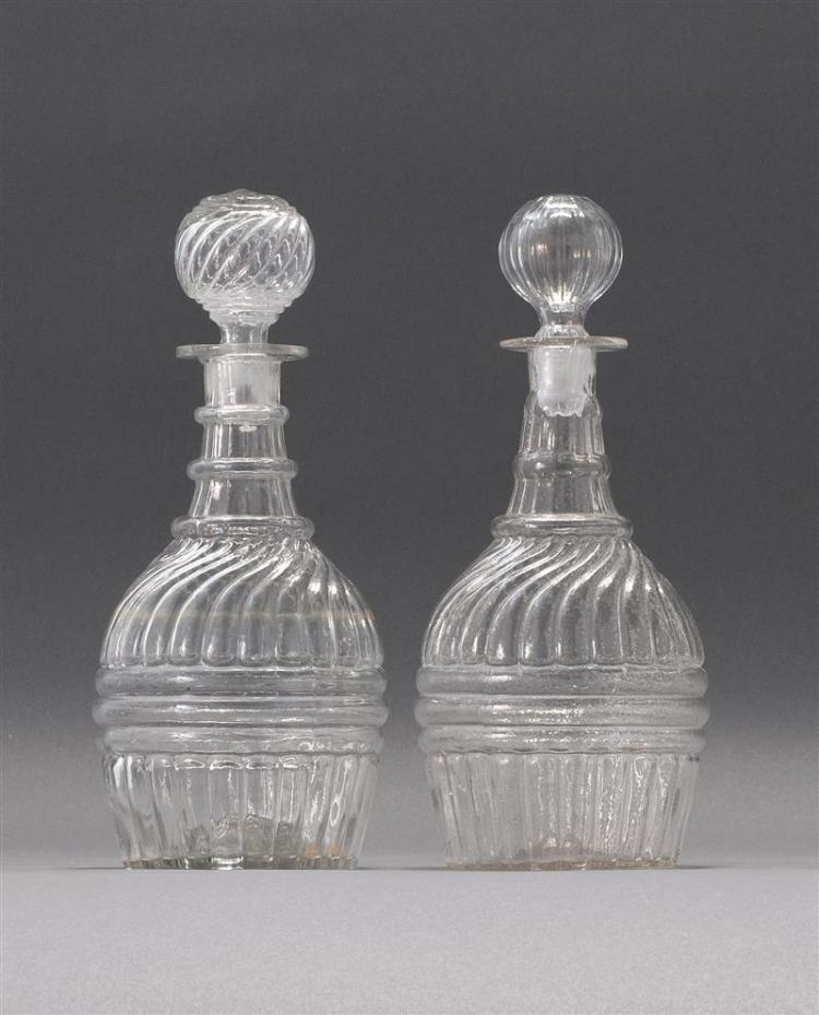 """PAIR OF CLEAR GLASS BLOWN 3-MOLD DECANTERS McKearin #GI-27. Both with period stoppers. Heights 10.75"""". From a Cape Cod Collection of..."""