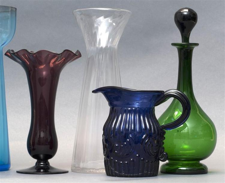 TEN ASSORTED CLEAR AND COLORED GLASS ITEMS Includes three hyacinth vases, two ruffled-rim vases, three dresser bottles, a footed gla...