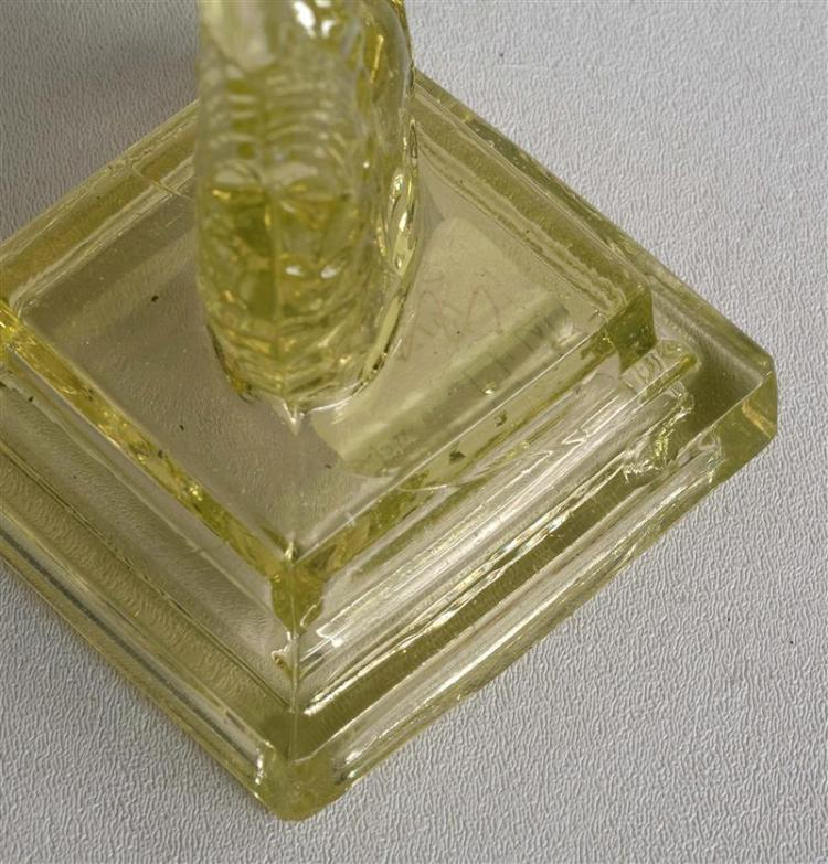 PAIR OF SANDWICH GLASS COMPANY PRESSED GLASS DOLPHIN CANDLESTICKS In canary yellow. Double-stepped bases. Heights 10