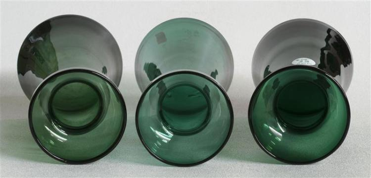 THREE SANDWICH GLASS COMPANY FREE-BLOWN HYACINTH VASES All in shades of green. Slightly varied forms. Heights from 8