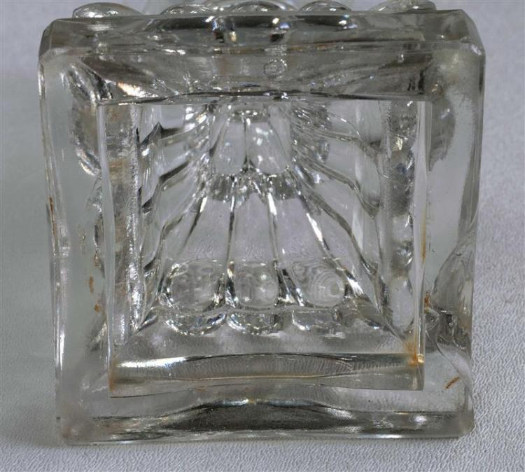 THREE SANDWICH GLASS COMPANY CLEAR GLASS CANDLESTICKS In varied forms. All with free-blown socles and pressed bases. Heights from 7