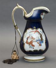 ENGLISH PORCELAIN JUG Decorated with scenes of Chinese figures against a cobalt blue ground. Unmarked. Height 11