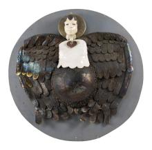 CONTEMPORARY CERAMIC, METAL, AND WOOD SCULPTURE Depicting Mother Earth in the form of an angel. Unsigned. Mounted to a circular wood...