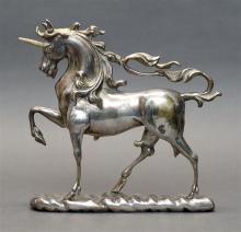 SILVERED BRASS FIGURE OF A UNICORN Unmarked. Height 8.5