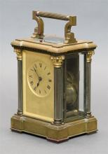 HOWARD & CO. FRENCH BRONZE CARRIAGE CLOCK The gilt face with Roman numerals. Housed in case with beveled glass panels and columns wi...